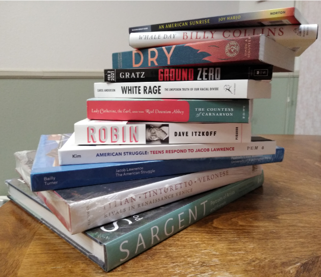 A stack of books  Description automatically generated with medium confidence