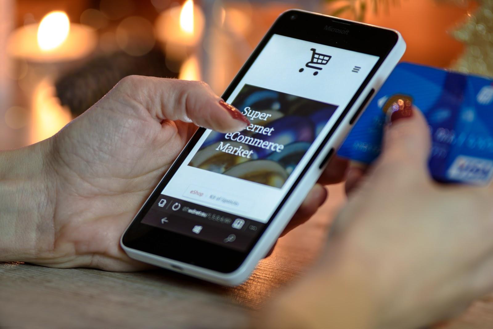 A person makes a purchase via their phone
