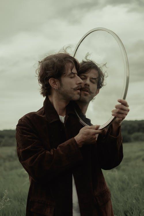 Man Carrying Mirror