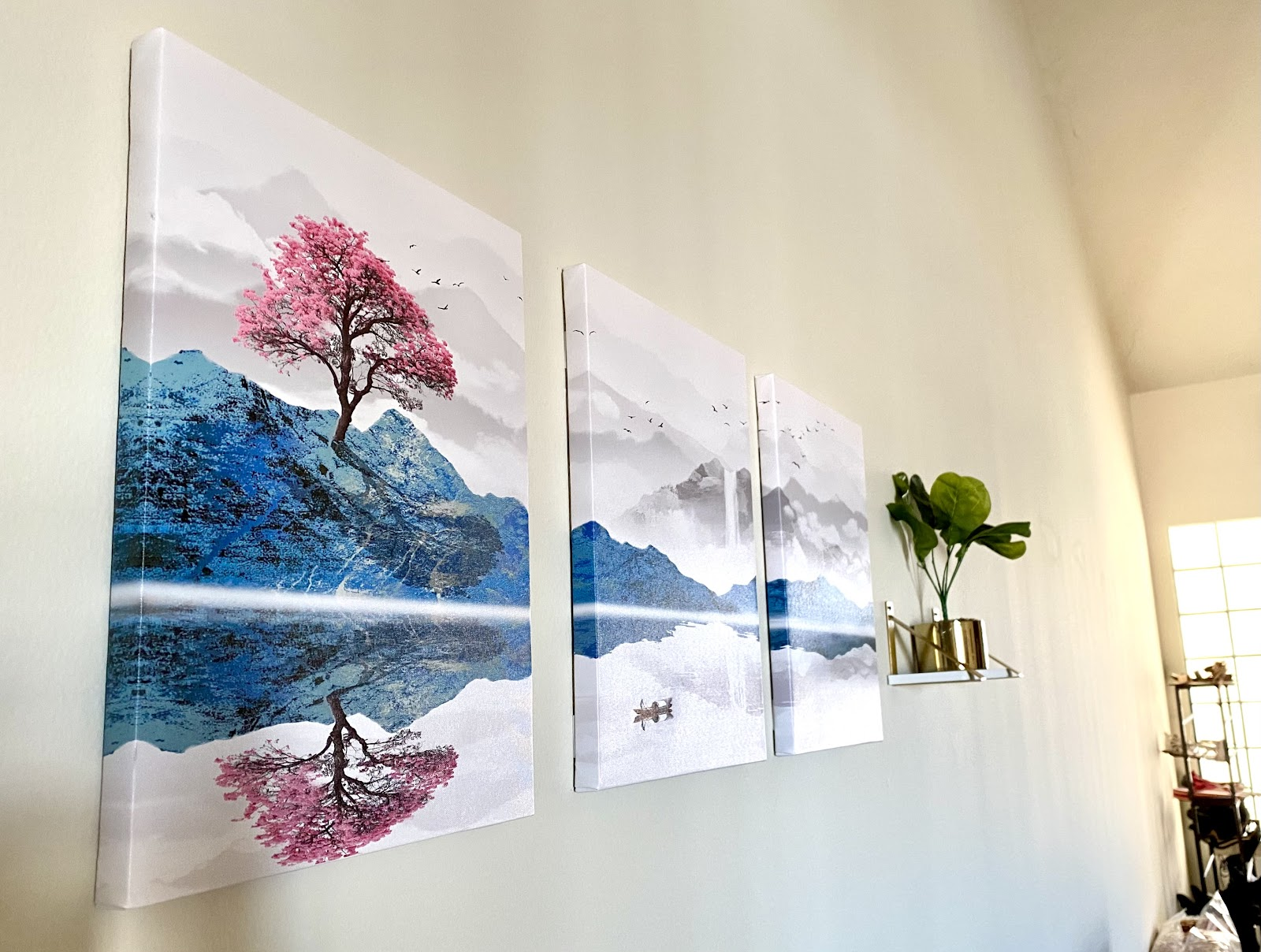 minimalist home decor featuring cherry blossom panel paintings and plant on shelf