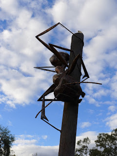the big meat ant is seen crawling down a big pole