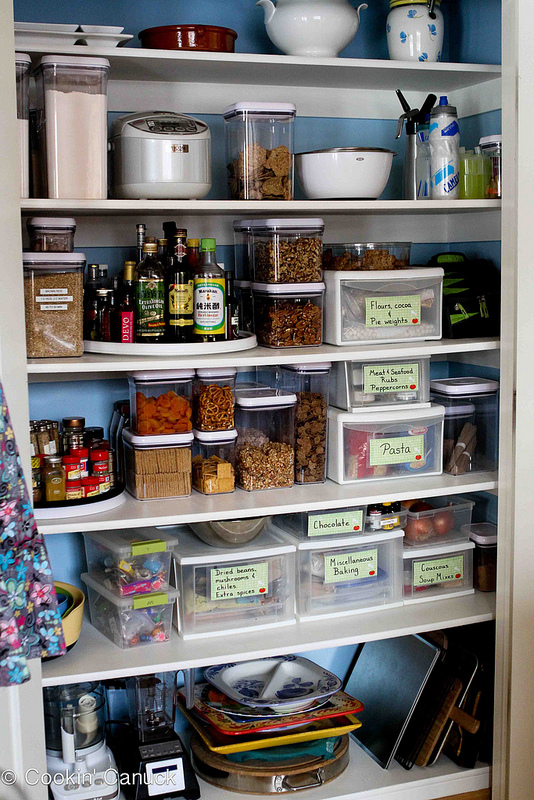 Small kitchen with organised boxes
