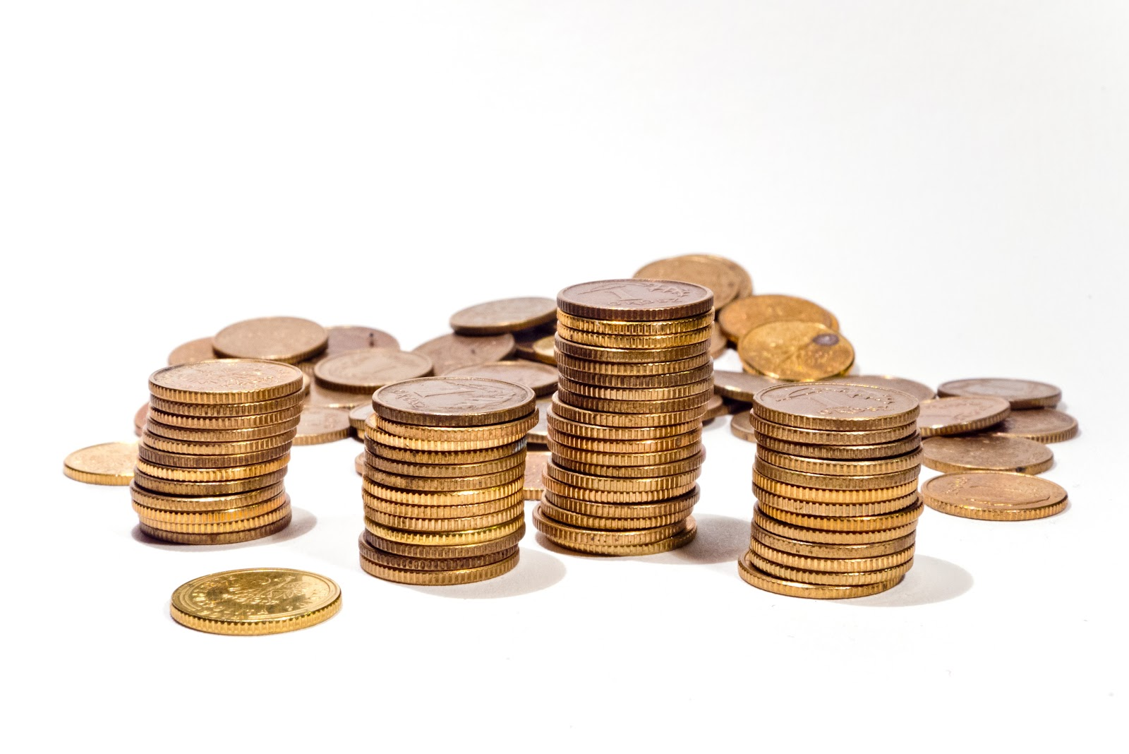stack of coins on a white background