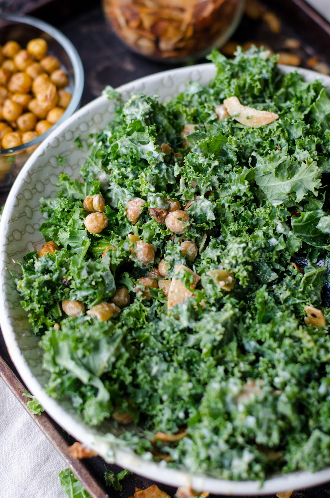 A salad packed with nutrients will keep you full for longer. This kale salad with chickpeas offers protein and fiber.