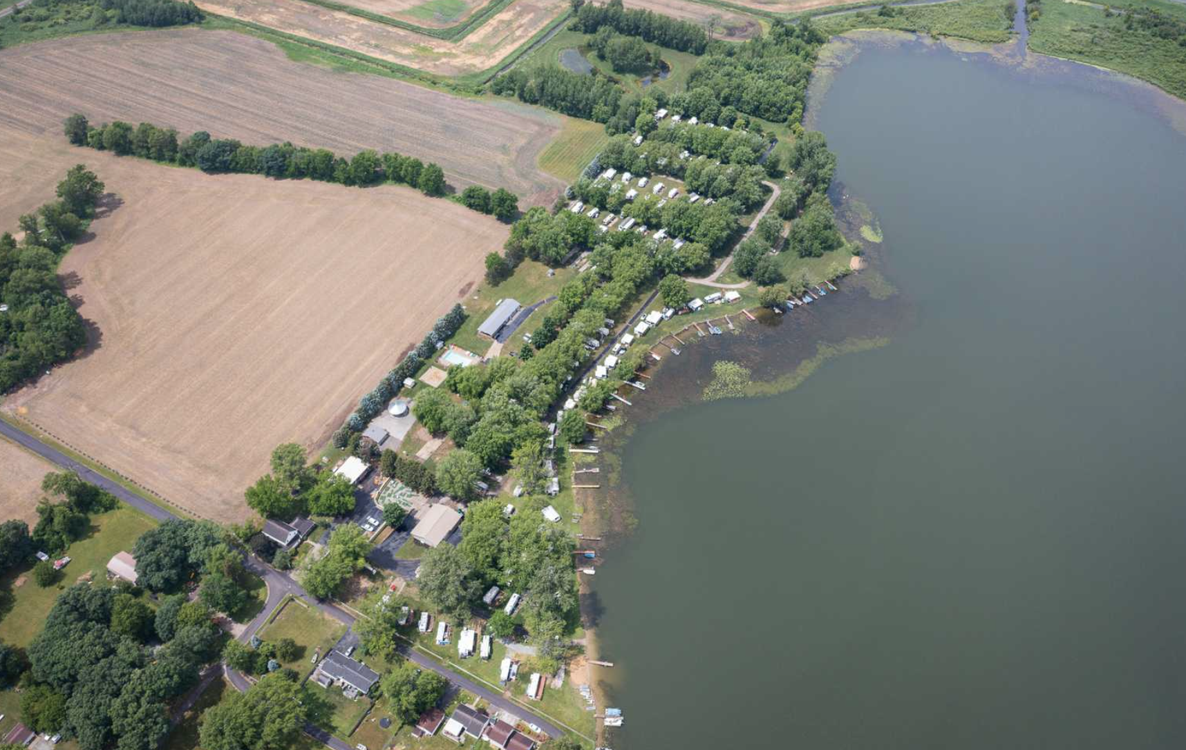 aerial view of campground next to large body of water