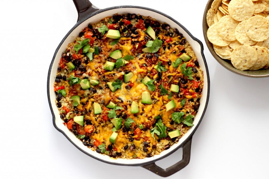 Enamel Dutch Oven of Quinoa Enchilada Dip with bowl of Chips