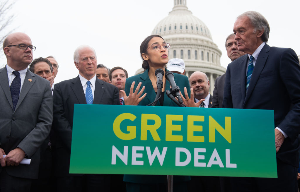 American Jobs Plan. Rep. Alexandria Ocasio-Cortez (D-NY) and Sen. Ed Markey (R) (D-MA) announce the socialist Green New Deal proposal in Washington, D.C. on February 7, 2019. The far-left Washington Post and Republicans have joined forces in a rare meeting of the minds to describe Biden's new American Jobs Plan as the Green New Deal.