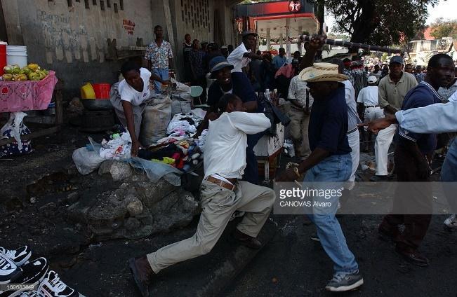 http://cache2.asset-cache.net/gc/160683649-demonstrations-in-haiti-against-president-gettyimages.jpg?v=1&c=IWSAsset&k=2&d=GkZZ8bf5zL1ZiijUmxa7QdGzafzL1W%2BInVIhPzFuF3CpCt0KsjqfTNsBou%2FREVvIJQBeR%2BACoJfk2F%2BOay%2BM1A%3D%3D