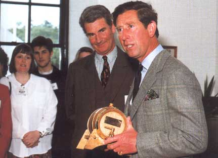 Prince Charles with a miniature barrel of Laphroaig, which surprisingly relates to migrating to SaaS in telecom