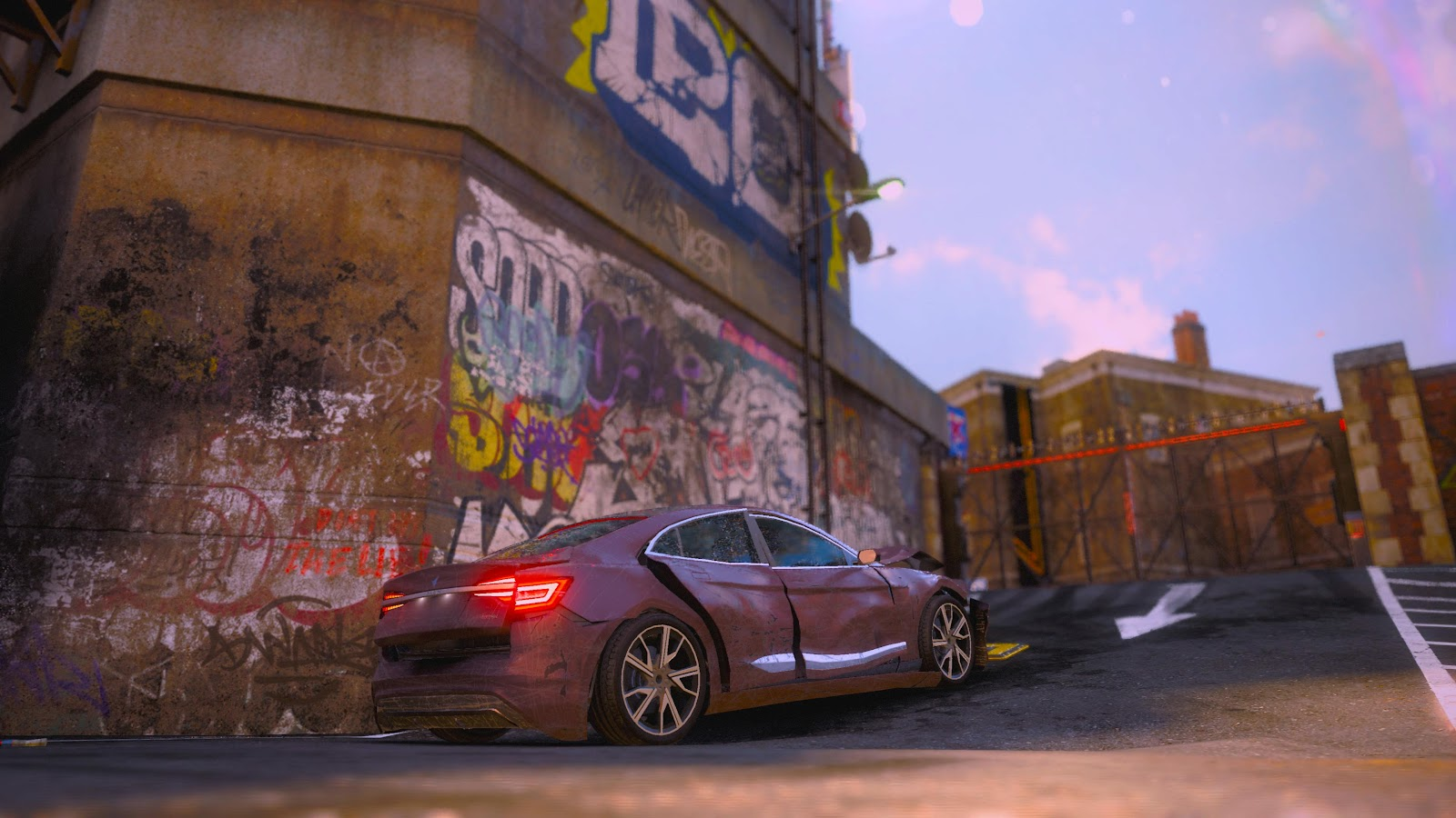 A crashed up car beside a brick wall covered in graffiti.