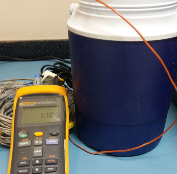 calibrating a digital thermometer with a thermocouple probe in an Ice Bath