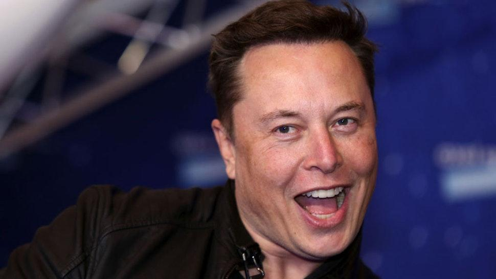 Elon Musk, founder of SpaceX and chief executive officer of Tesla Inc., arrives at the Axel Springer Award ceremony in Berlin, Germany, on Tuesday, Dec. 1, 2020. Tesla Inc.will be added to the S&P 500 Index in one shot on Dec. 21, a move that will ripple through the entire market as money managers adjust their portfolios to make room for shares of the $538 billion company. Photographer: Liesa Johannssen-Koppitz/Bloomberg