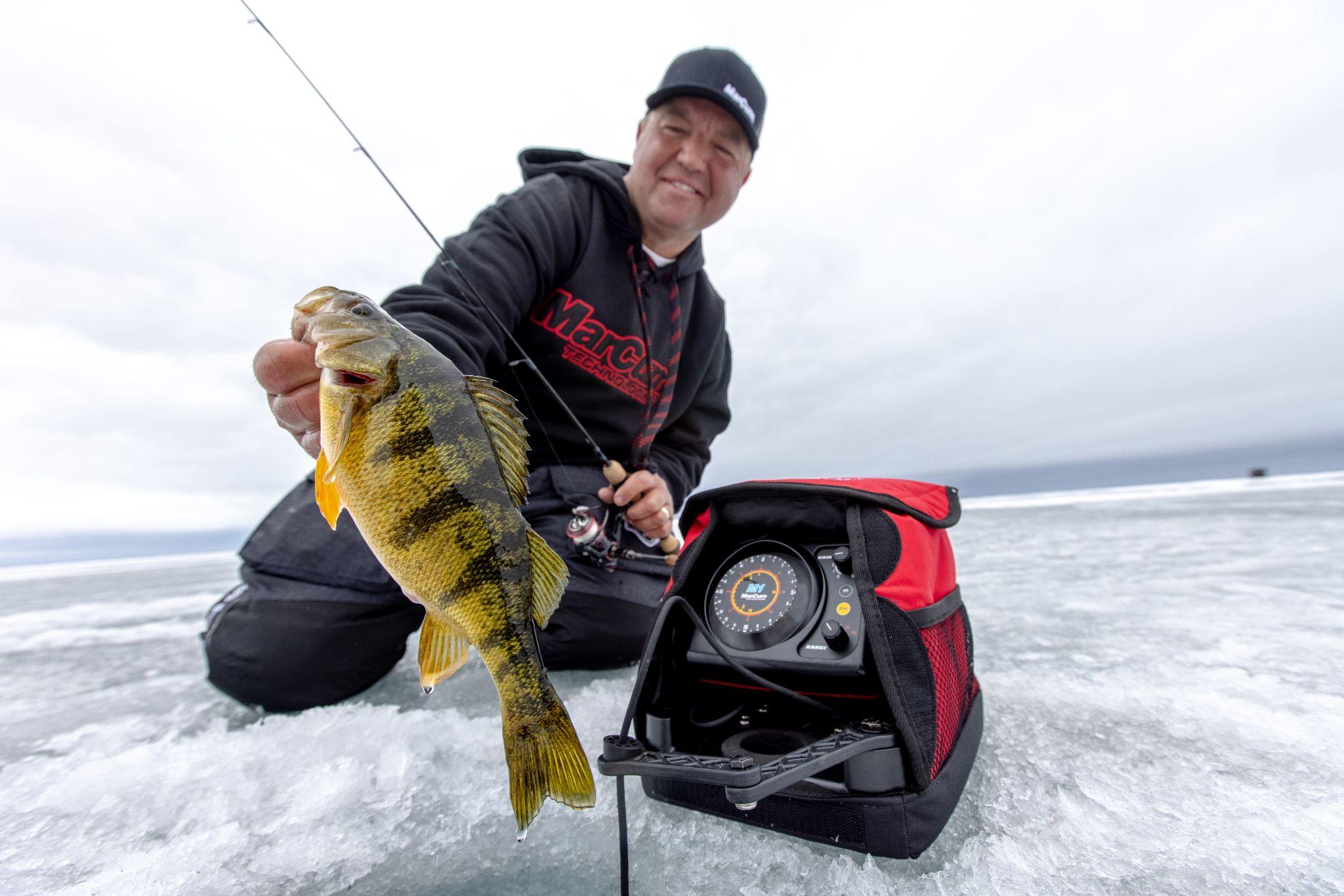 Tony Roach showing off his perch caught with a MarCum M1 ice fishing flasher