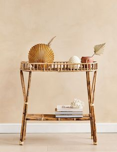 This two-tier bamboo shelf is perfect for using as a console in your hallway or a sidetable in your living room. We love the rustic bamboo design that has a distinct 1970's aesthetic. Use the top shelf for placing your coffee mug and a vase of flowers and store your favourite books and magazines on the lower shelf.