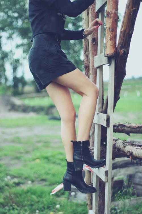 Girl climbing ladder