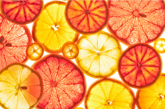 Multiple fruit slices with light shining through them