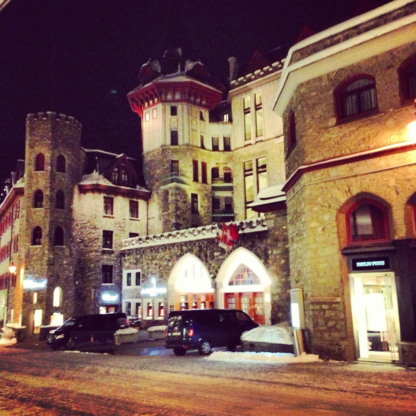 badrutt's palace hotel building seen at night during wintertime. the hotel's classical architecture, castle style and famous tower. Be sure to see it on an Italy road trip