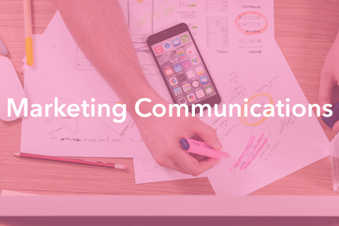 """An image of someone drafting a marketing plan. Bold text is placed over the image. It reads: """"Marketing Communications""""."""