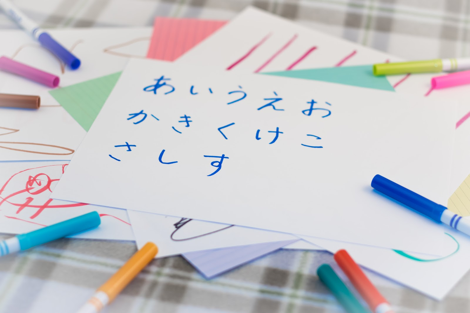 Another techniques of remembering Hiragana characters is writing on the paper.