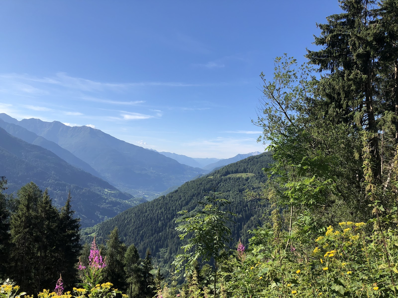 Cycling Mortirolo from Edolo - distant view of mountains and sky