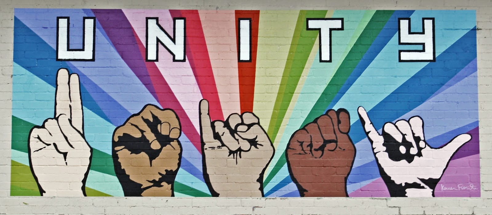 """""""UNITY"""" in text and ASL letters with a rainbow behind"""