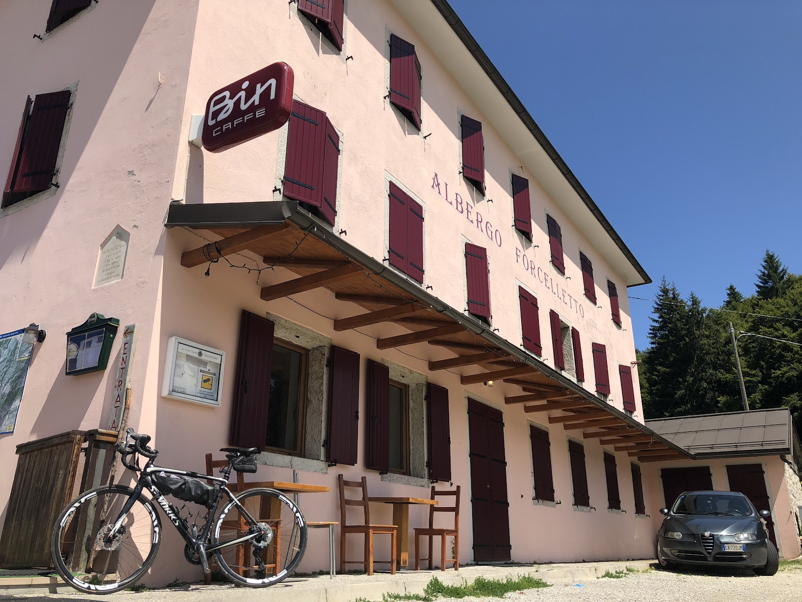 Cycling Monte Grappa from Seren - bike leaning against Albergo Forcelletto