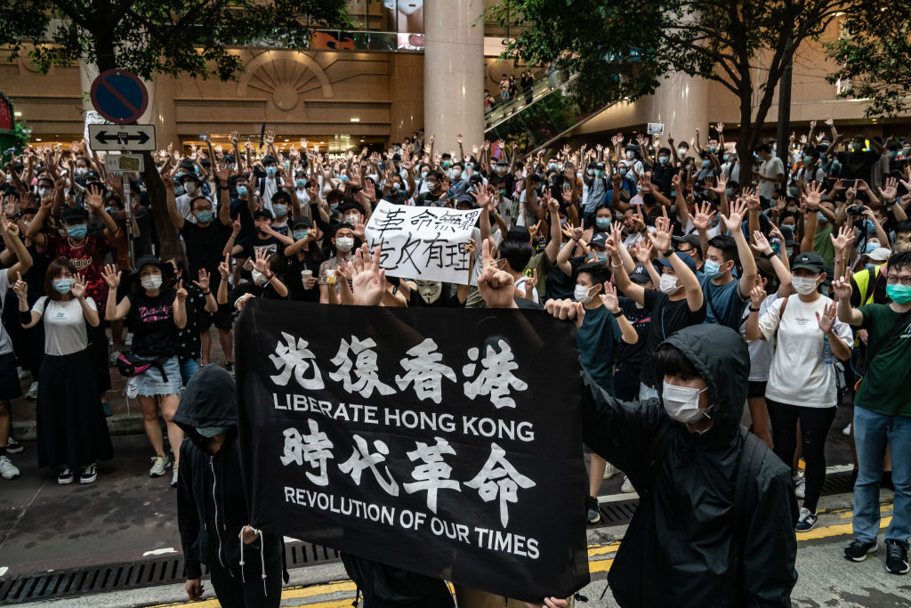 Hong Kong Citizens protest the CCP-installed National Security Law law on July 1, 2020 in Hong Kong. The situation in the city boils down to factional struggles within the Party that stem back to corruption and cronyism created under former CCP Chairman Jiang Zemin.