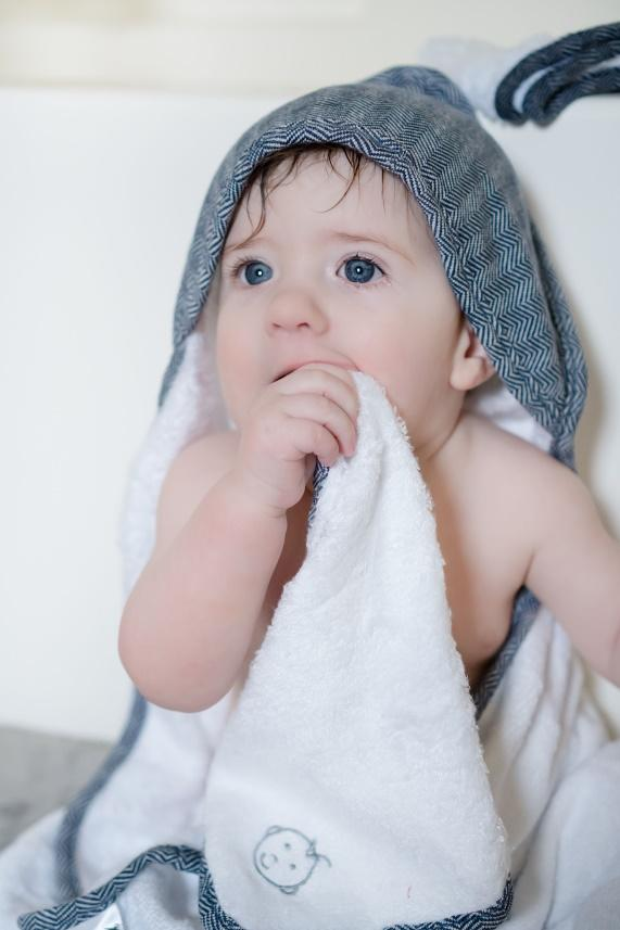 A little girl holding a towel