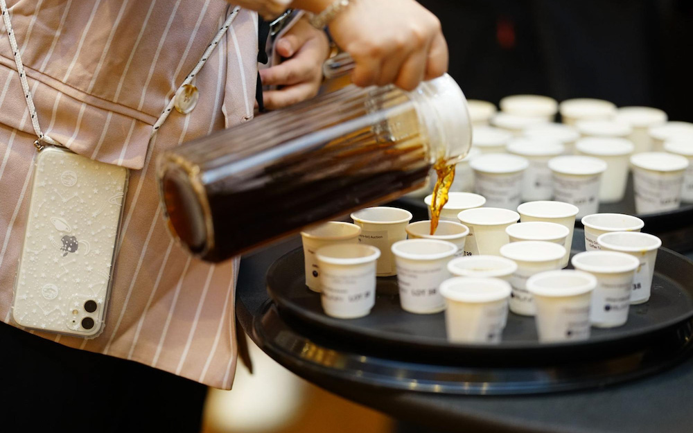 pouring filter coffee into cups