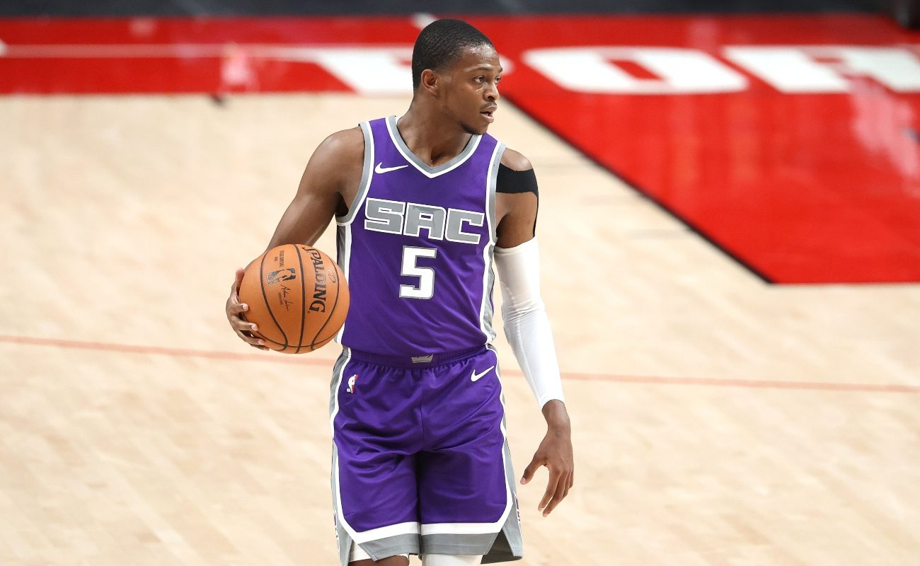De'Aaron Fox #5 of the Sacramento Kings dribbles with the ball in the second quarter against the Portland Trail Blazers during their preseason game at Moda Center on December 11, 2020 in Portland, Oregon. (Photo by Abbie Parr/Getty Images)