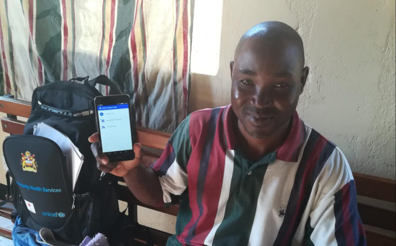 A frontline worker shows off his mobile data collection app