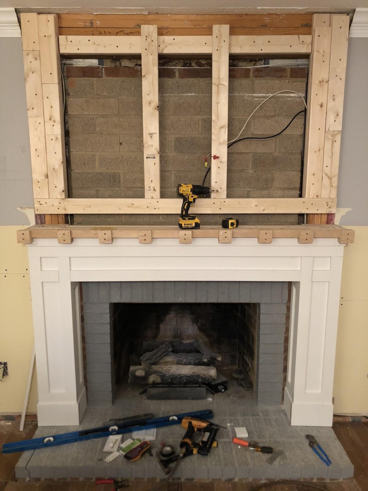 white shiplap fireplace