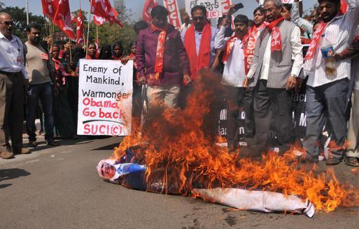 Activists of the Socialist Unity Centre of India (Communist) burning an effigy of US President Barack Obama in Hyderabad on Saturday, during a protest against his visit to India on January 26. Photo: G. Ramakrishna