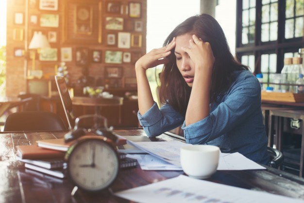 Woman stressed on work desk