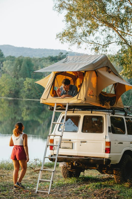 Woman and Man camping with their car