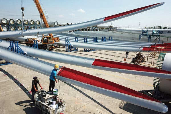 """Turbine blades at a manufacturing plant in Jiangsu Province in China. """"There is simply no reason why the blades for wind turbines can't be built in Pittsburgh instead of Beijing,"""" Mr. Biden said on Wednesday."""