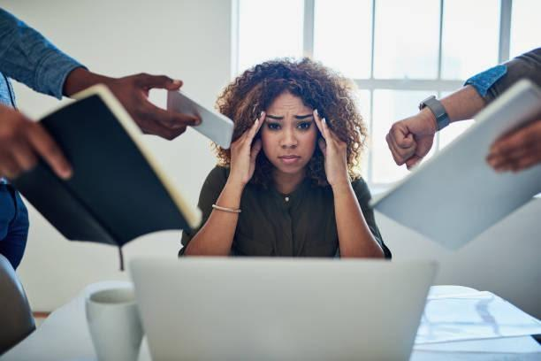 Can I get a moment to breathe? Shot of a stressed out young woman working in a demanding career deadline stock pictures, royalty-free photos & images