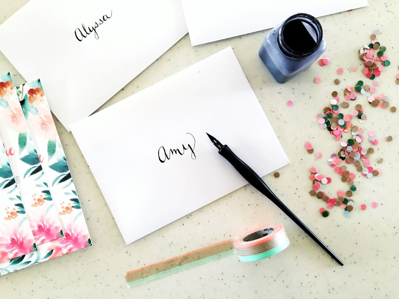 invitations in envelopes with names painted on the front