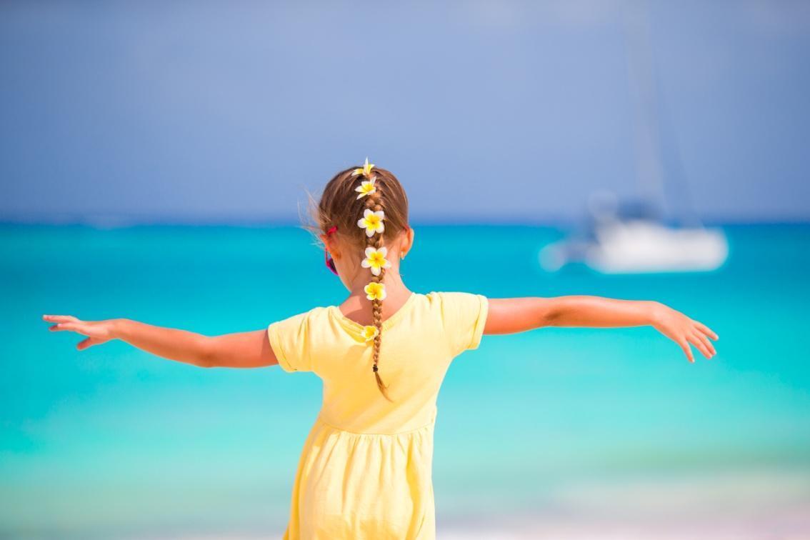 adorable-little-girl-with-frangipani-flowers-in-ha-ET7ZB7M (1).jpg