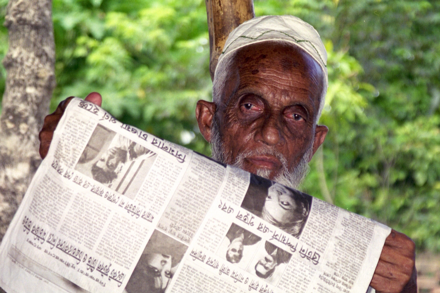 man reading newspaper in bangladesh.jpg