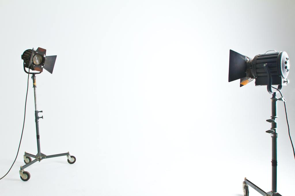This photo features a video lighting set up and serves as an example when it comes to properly lighting your video.