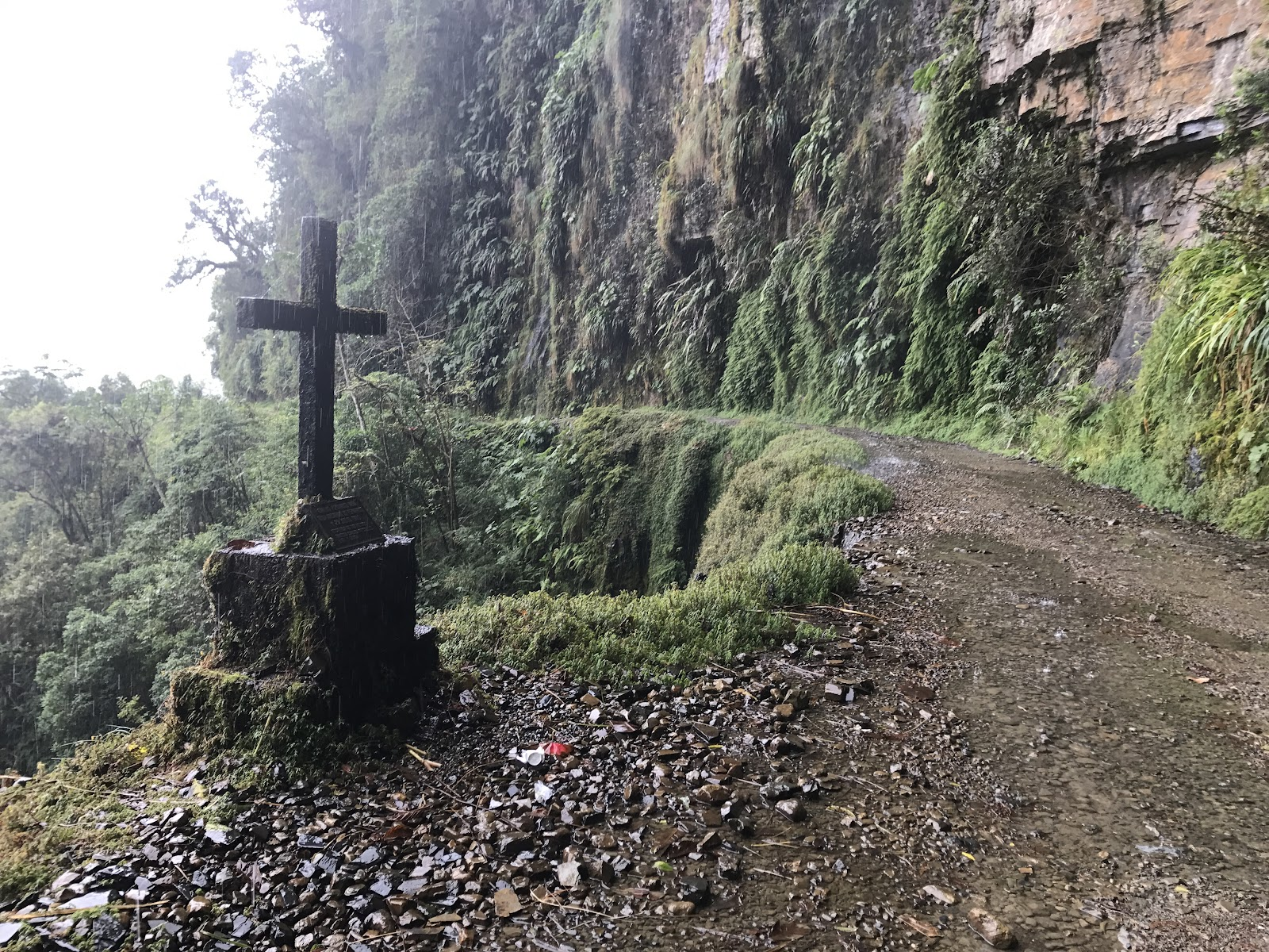 Main memorial cross on death road with narrow road
