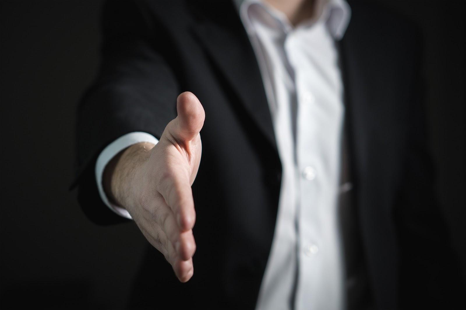 man reaching for handshake