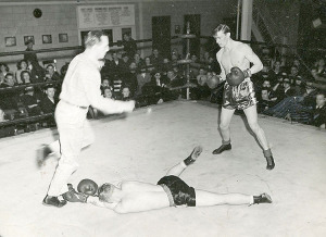 Zane (at right) boxing in the Navy for additional leave