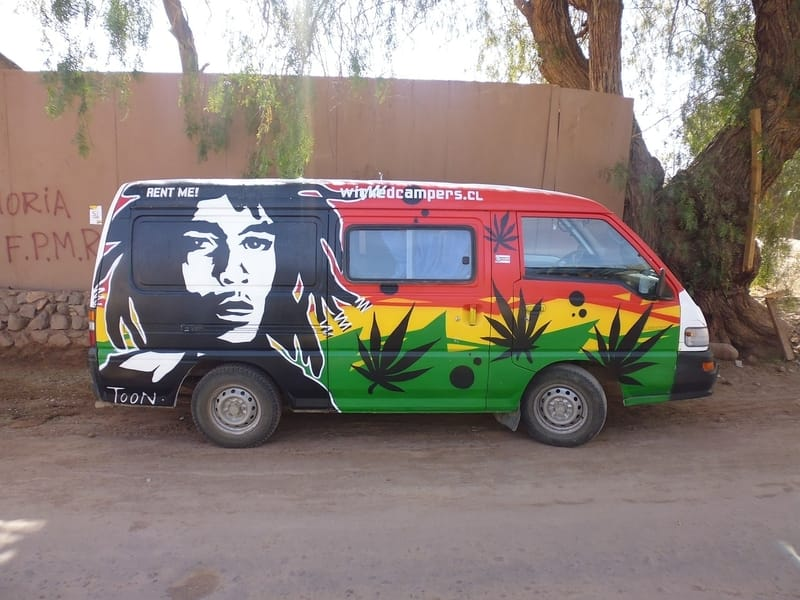 VW van painted jamaican colors with bob marley photo