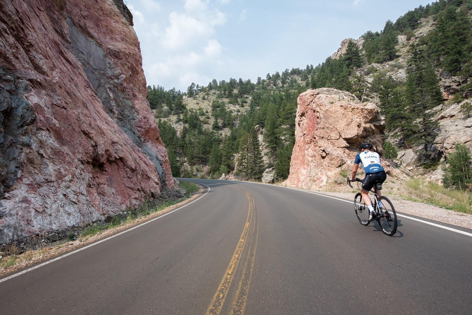 Cyclist riding bike up Hwy 34 to Trail Ridge