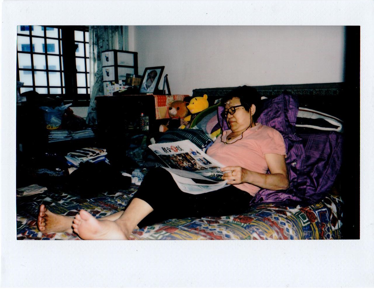 My Mother relaxing on her bed