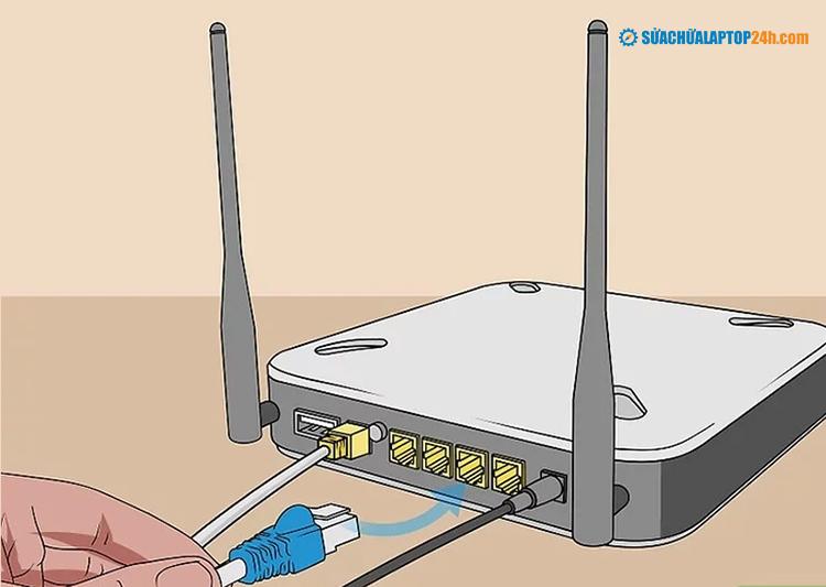 Cắm một đầu của cáp Ethernet khác vào bộ định tuyến
