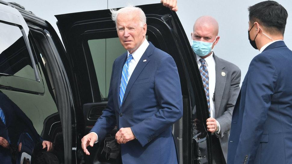 US President Joe Biden looks on after arriving on Airforce One at Chicago OHare International Airport in Chicago, Illinois on October 7, 2021, as he travels to promote the importance of Covid-19 vaccine requirements.