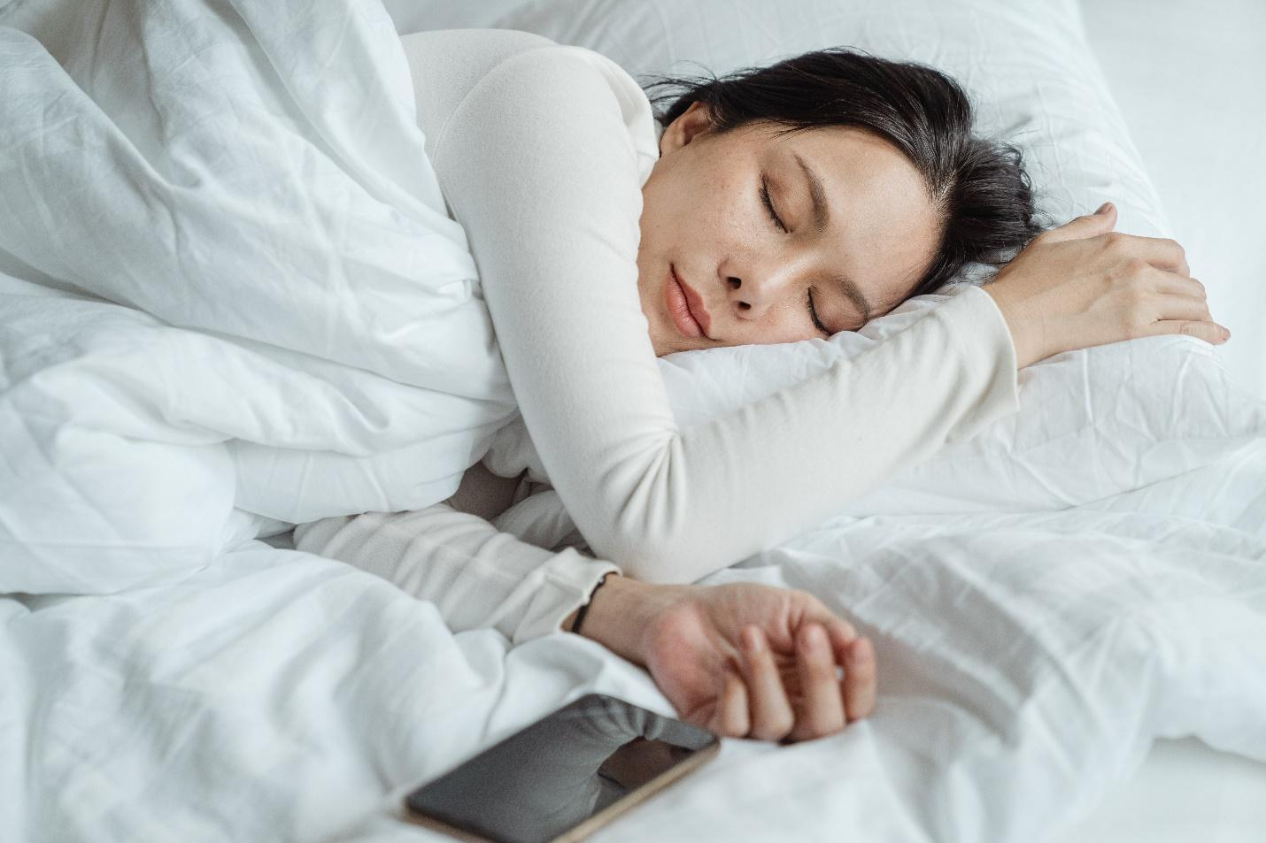 A person sleeping on a bed  Description automatically generated with low confidence